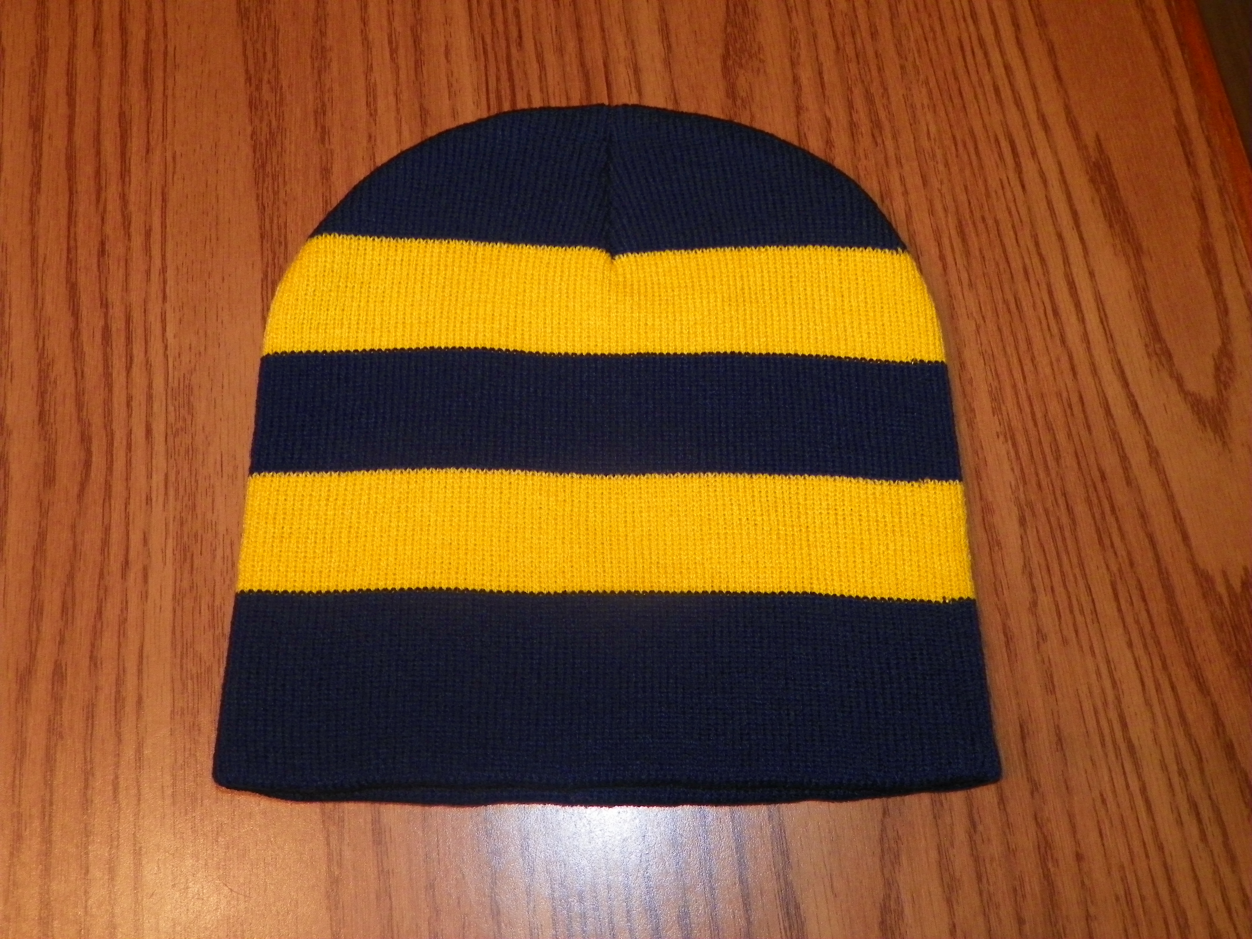 a1785e1b9 Navy and Gold Striped Beanie Hat